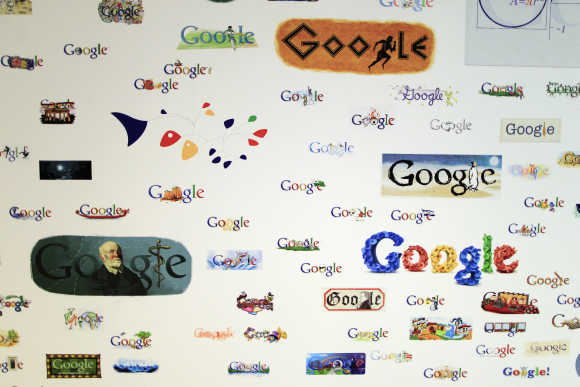 Google homepage logos are seen on a wall at the Google campus near Venice Beach, in Los Angeles.