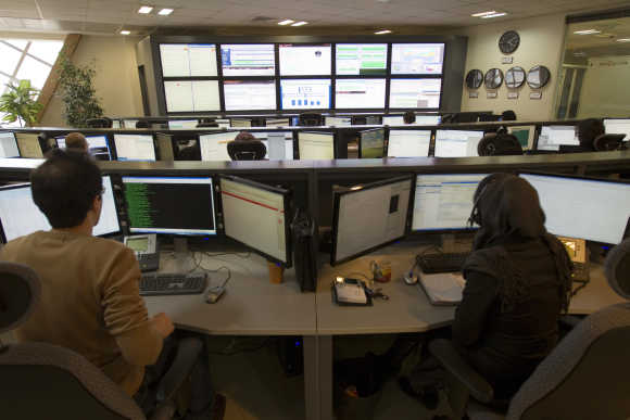 Technicians monitor data flow in the control room of an Internet service provider in Tehran.