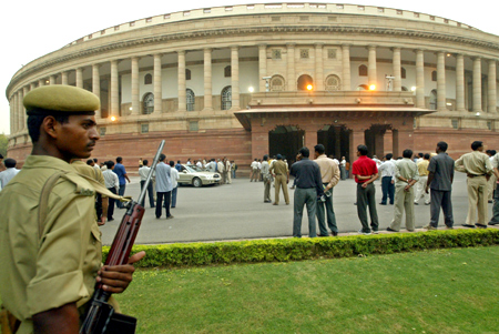An Indian policeman keeps guard outside the premises of parliament house in New Delhi.