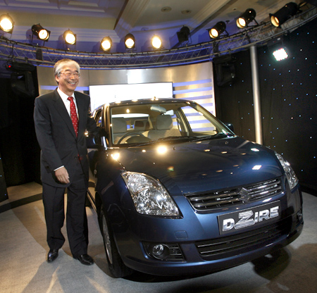 Managing Director of Maruti Suzuki, Shinzo Nakanishi, poses with 'DZire'.