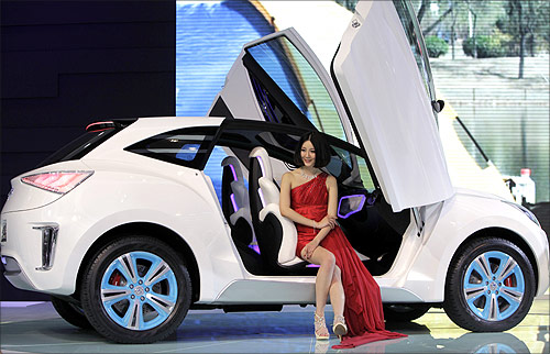 A model sits in a Haval E concept car from China's Great Wall Auto at Auto China 2012 in Beijing.