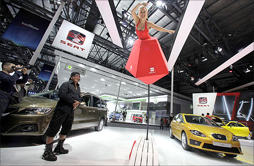 A model performs at a SEAT booth at Auto China 2012 in Beijing.