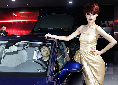 A visitor sits in the Audi A7 35 FSI at Auto China 2012 in Beijing.