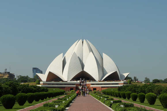 Tourists visit the The Bahai House of Worship known as the 'Lotus Temple' in New Delhi.