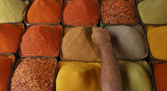 A man sells spices at a market in Karachi.