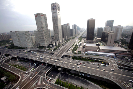 A view of the Guomao Bridge (bottom) in Beijing's Central Business District.