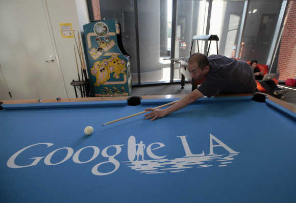 An employee plays pool at the Google campus near Venice Beach in Los Angeles.