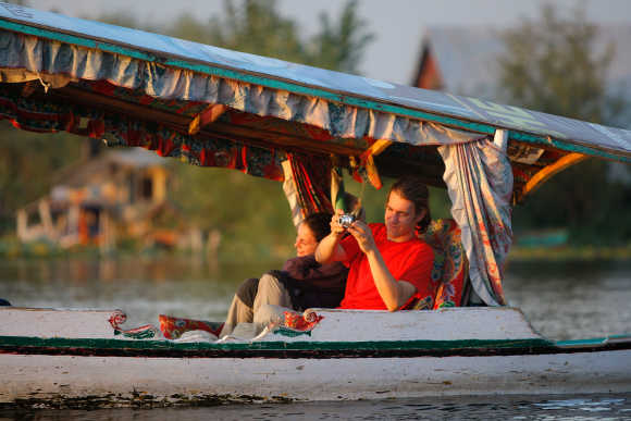 Tourists cruise along Dal Lake taking photos in Srinagar, Kashmir. Photo is for representation purpose only.