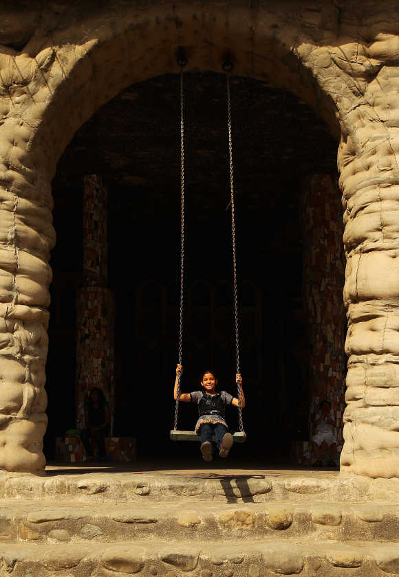 A young girl plays on the swings at the Rock Garden in Chandigarh.