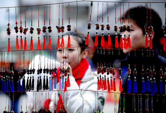 People shop during the Lunar New Year of the Rabbit in Shenyang, Liaoning Province of China.