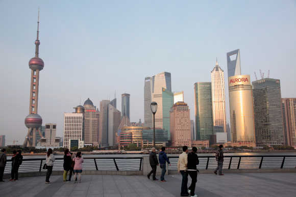 People walk in the Bund area of Shanghai.