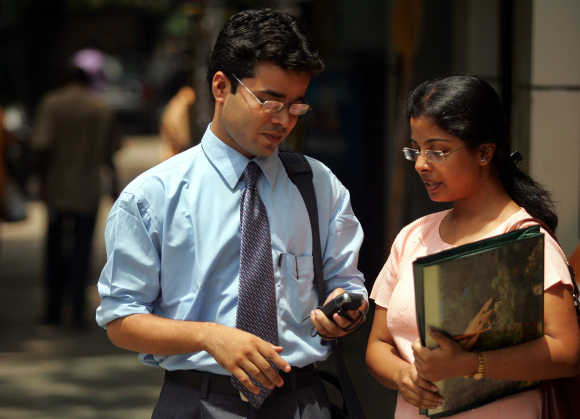 A student checks his mobile phone in Kolkata.