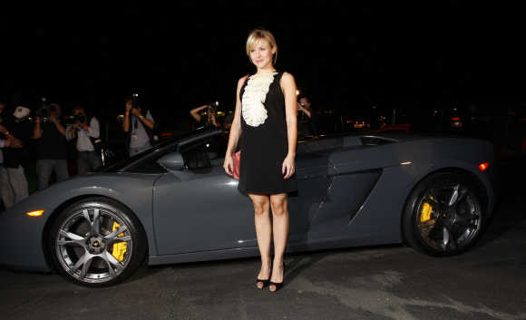 Actress Kristen Bell arrives at the grand opening of Lamborghini Calabasas in Calabasas, California.