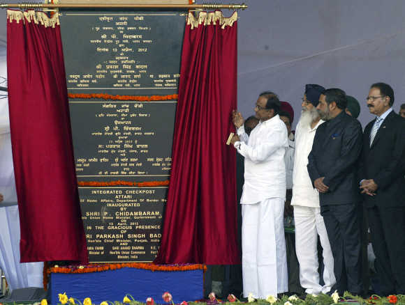 Home Minister Palaniappan Chidambaram unveils a plaque during the inauguration of the Integrated Checkpost at the Attari border near Amritsar.
