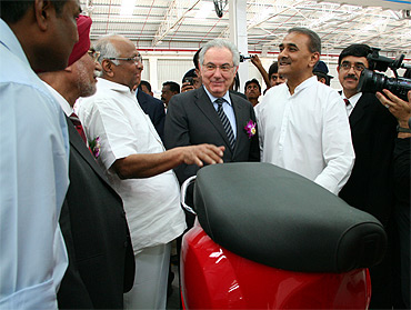 Group chairman and CEO of Piaggio Roberto Colaninno with Agriculture Minister Sharad Pawar and Heavy Industries Minister Praful Patel.