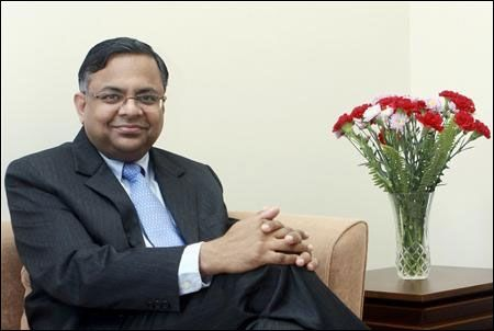 N Chandrasekaran poses in this undated handout photograph taken inside his office in Mumbai.
