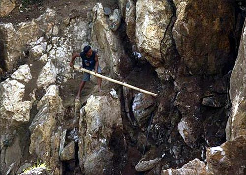 Searching for gold in Indonesia's hills