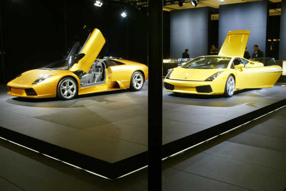 Lamborghini Gallardo, right, and the Murcielago roadster, left, stand on display at the Los Angeles Auto Show.