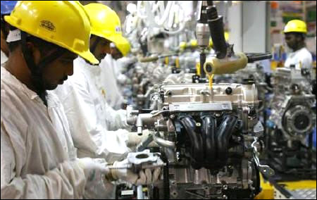 Employees work inside Maruti Suzuki petrol engine plant on the outskirts of New Delhi.