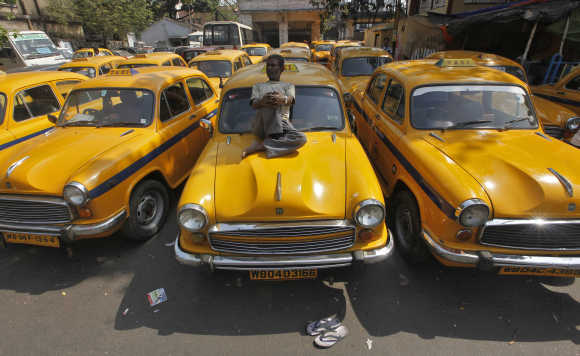Some companies deduct salaries of taxi drivers for reaching destination late.