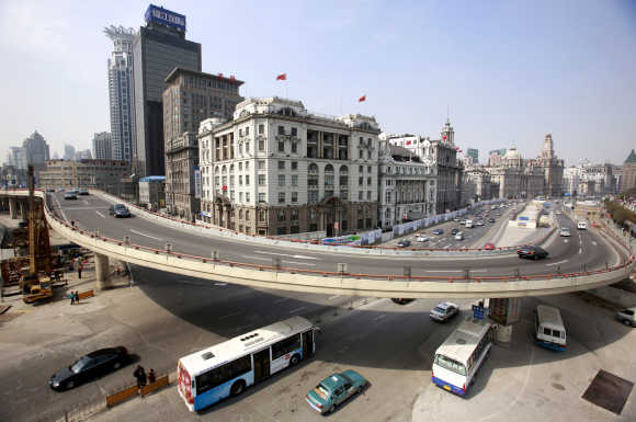 Traffic flows on a flyover at the Bund in Shanghai.