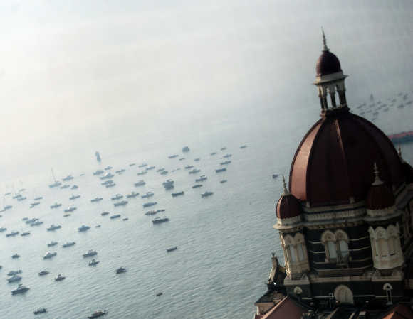 The domes of the Taj Mahal hotel are seen in front of the Arabian Sea in Mumbai.