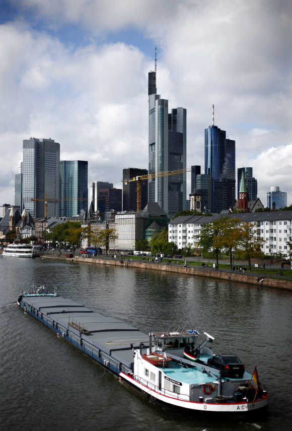 The skyline of Frankfurt with its bank towers is seen under clouds.