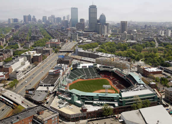 Fenway Park, home of the Boston Red Sox, is seen in front of the Boston, Massachusetts, skyline.