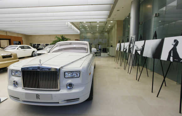 A cornish white Rolls-Royce Phantom car is on display at a Rolls-Royce showroom in Dubai.