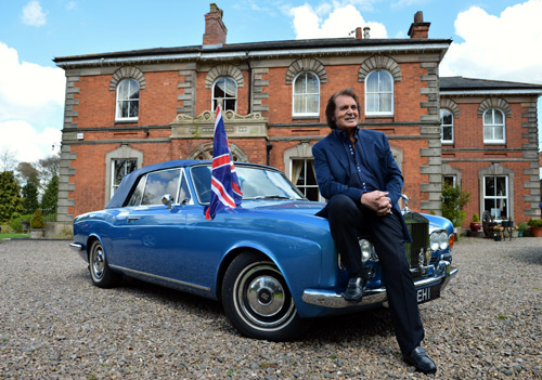 Englebert Humperdinck poses at his home for photographs next to his Rolls Royce