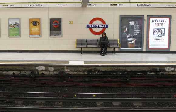 A passenger waits at Blackfriars London Underground station in London.
