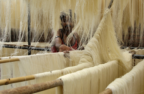 A worker dries vermicelli, a specialty eaten during the Muslim holy month of Ramadan.