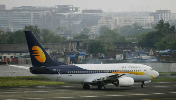 A Jet Airways aircraft waits for take off on the tarmac at the airport in Mumbai.