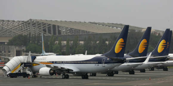 Jet Airways aircraft stand on the tarmac at the domestic airport terminal in Mumbai.