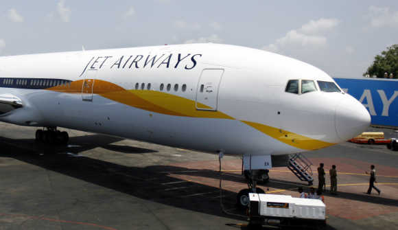 A Jet Airways Boeing 777-300ER aircraft sits on the tarmac at Mumbai airport.
