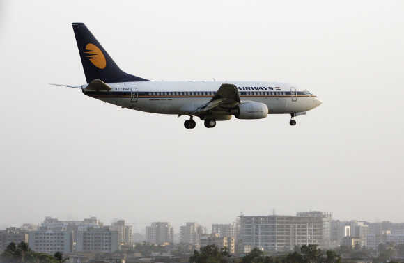 A Jet Airways plane prepares to land at Mumbai airport.