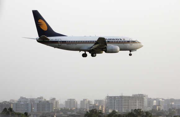 A Jet Airways plane prepares to land at Mumbai airport.