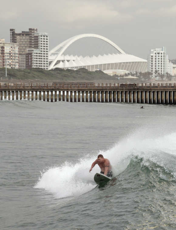 A knee boarder catches a wave on Durban's beach front.