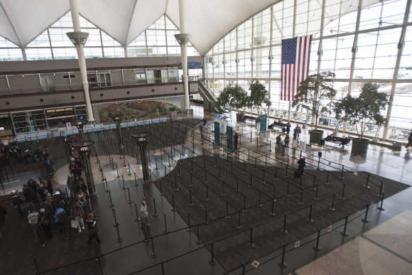 Passengers wait in security lines at the Denver International Airport.