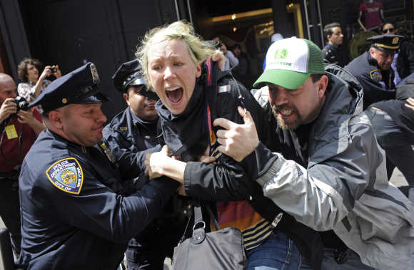 Occupy Wall Street demonstrators clash with police officers in New York.