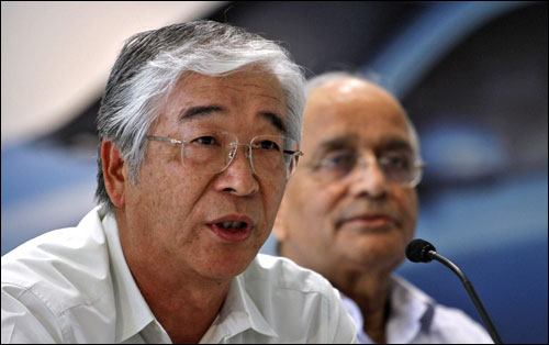 Maruti Suzuki India's MD and CEO Shinzo Nakanishi (L) speaks, beside Chairman R C Bhargava during a news conference in New Delhi on July 21, 2012.