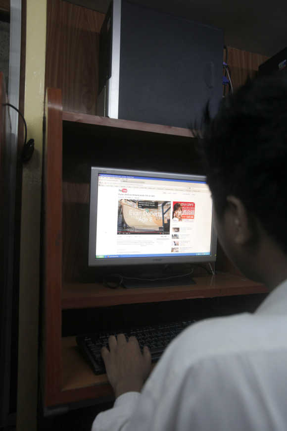 A man looks at online video portal YouTube at an internet cafe in Yangon, Myanmar.
