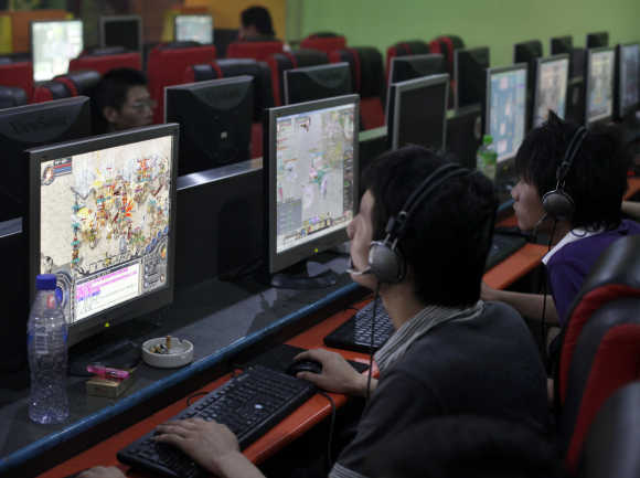 People play online games at an internet cafe in downtown Shanghai.