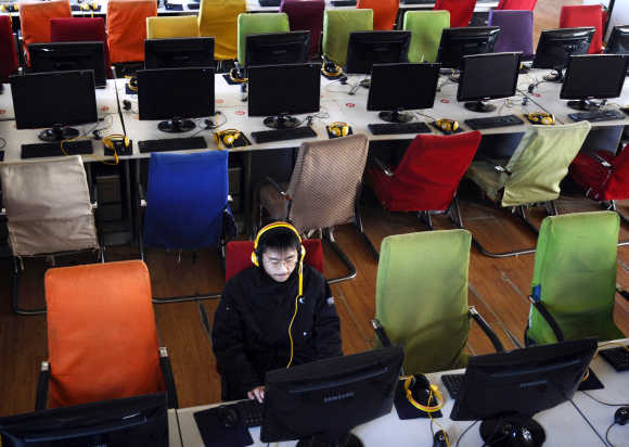 A customer uses a computer at an internet cafe at Changzhi, China.