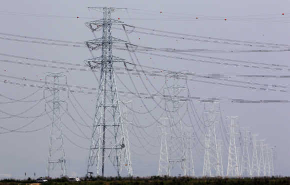 Transmission towers carrying solar and thermoelectric power from the Korea South East Power Co. plant are seen in Ansan, South Korea.