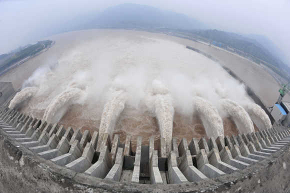 The Three Gorges Dam Project discharges flood water to lower the water level in the reservoir in Yichang, China.