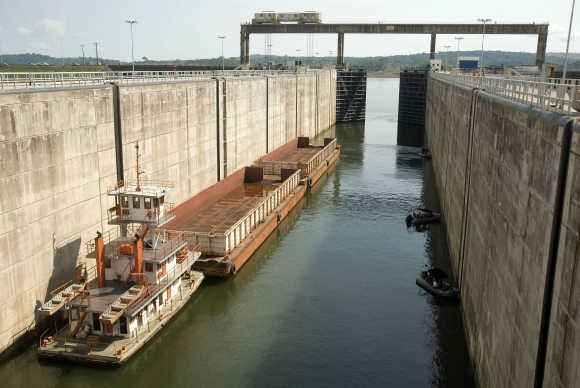 A cargo barge enters a lock of the Tucurui dam on the Tocantins River, Brazil.