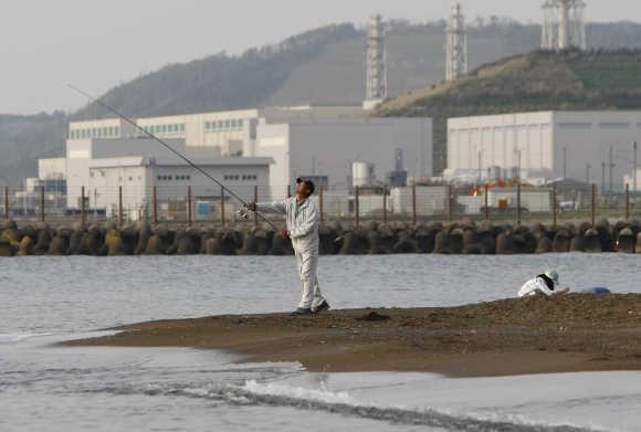 A man fishes near Tepco's Kashiwazaki-Kariwa nuclear plant in Kashiwazaki, Japan.