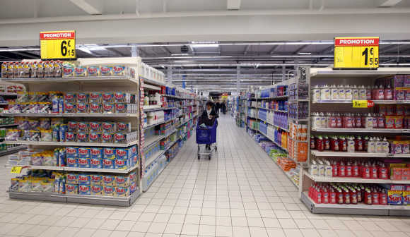 A customer shops in an aisle at Carrefour Planet supermarket in Nice, France.