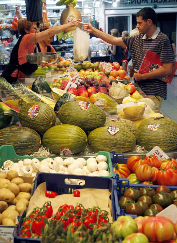 Man buys vegetables at El Masnou's local market near Barcelona.